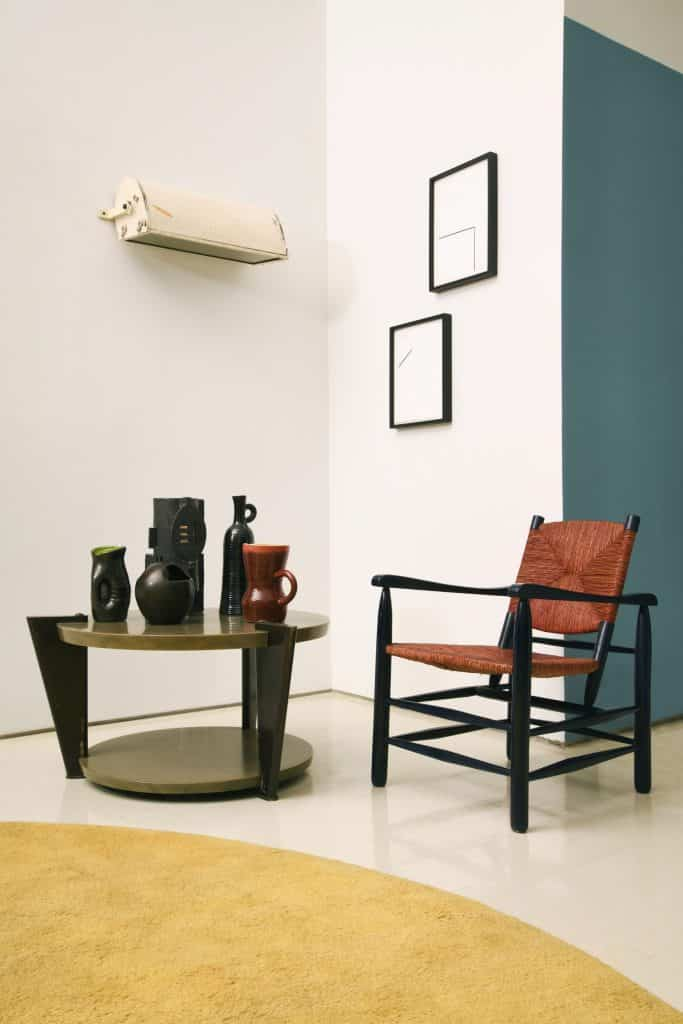 """A Michael Bargo room in the show """"The Decorator's Eye"""" at Magen H Gallery, in New York, featuring a Raymond Subes for Maison Dominique marble coffee table and a Charlotte Perriand armchair"""