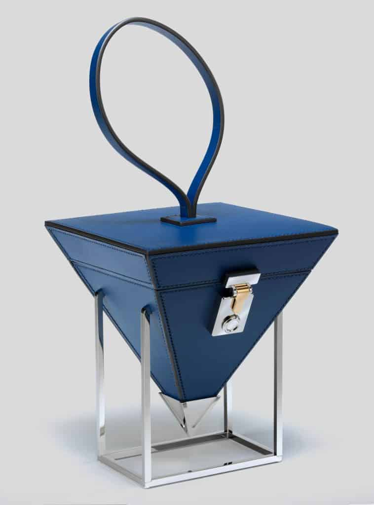 "The Moynat Mini Pyramide Gravity bag in the exhibition ""Bags: Inside Out,"" at London's Victoria and Albert Museum"