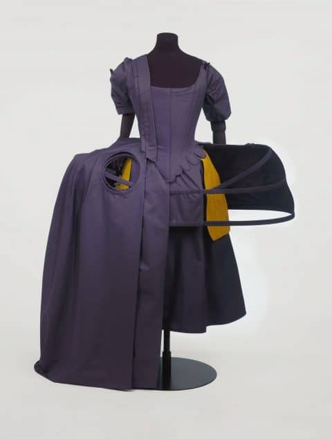 "A cutaway dress showing a 1740s detachable pair of yellow silk pockets, from ""Bags: Inside Out"" at the V&A in London"
