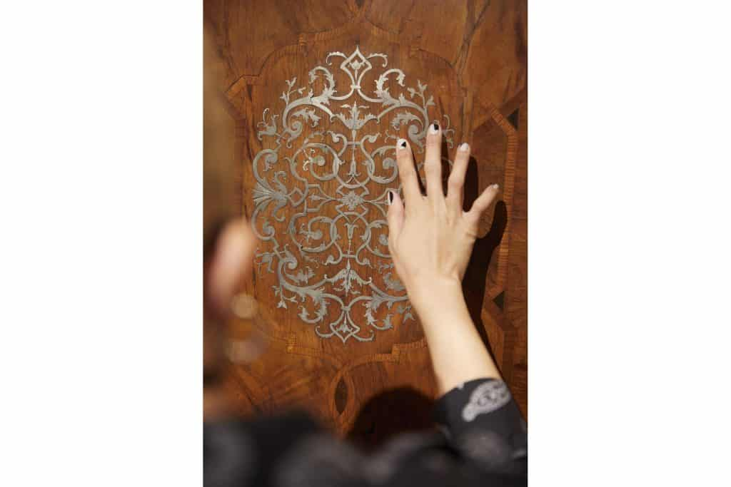 Interior designer Paris Grant at Arenskjold Antiques shop store dealer antiques gallery Hudson New York marquetry doors Southern German baroque-style cabinet chest
