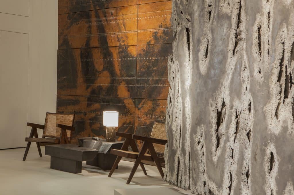 Pierre Sabatier's San Andreas coffee table and Beauvais I lamp along with his large-scale wall panels and sculptural screen at Magen H Gallery