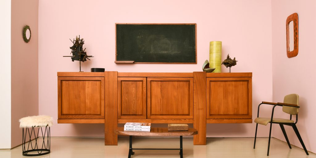A 1970s Pierre Chapo sideboard and a 1959 blackboard by Charlotte Perriand and Le Corbusier in a room designed by Robert Stilin at Magen H Gallery