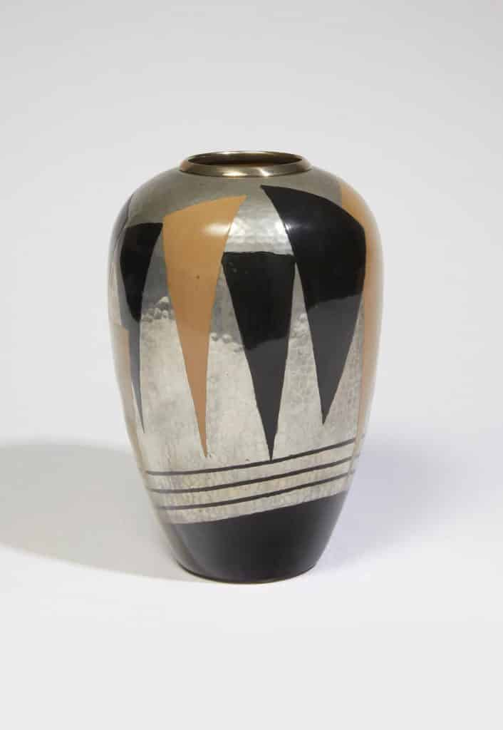A lacquered metal vase designed by Jean Dunand, offered by Galerie Marcilhac