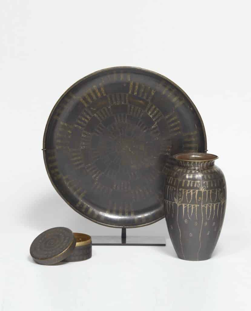 A brass pin box, copper plate and brass vase designed by Jean Dunand and offered by Galerie Marcilhac
