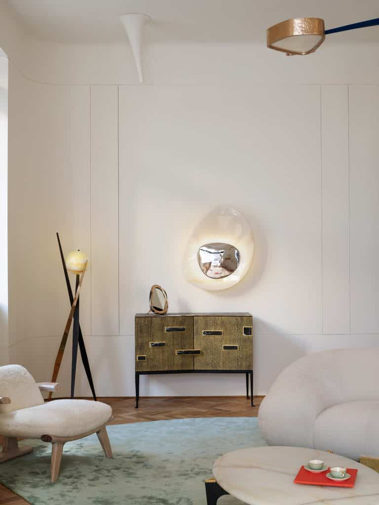 Achille Salvagni's Divo floor lamp next to his Palatino Lacewood cabinet in his London showroom