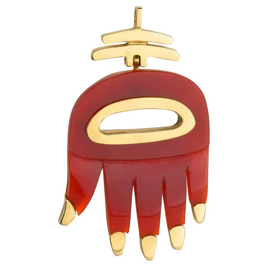 A carnelian Hand of the Heart pendant, designed by Aldo Cipullo and offered by Vendome Collection Inc.