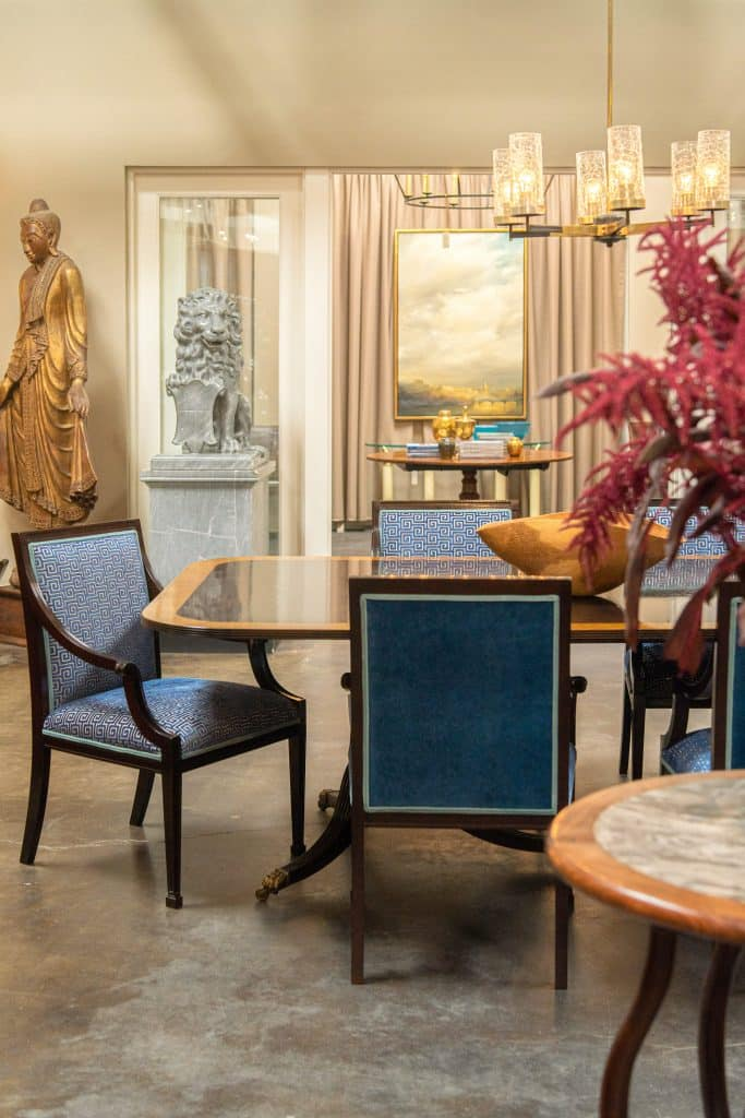 Hollis's Montgomery armchairs surround an English Regency–style dining table in the Hollis showroom