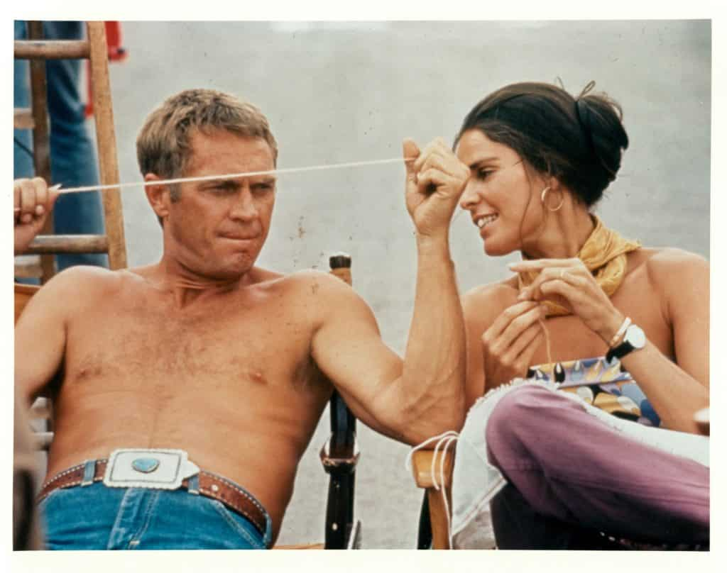 Ali MacGraw, right, wears the Love bracelet while sitting with Steve McQueen on the set of their 1972 film The Getaway.