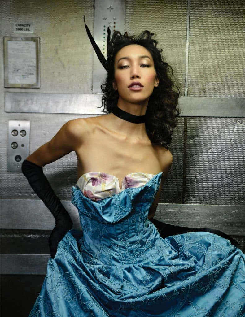 A model wearing a Morphew Collection silk gown