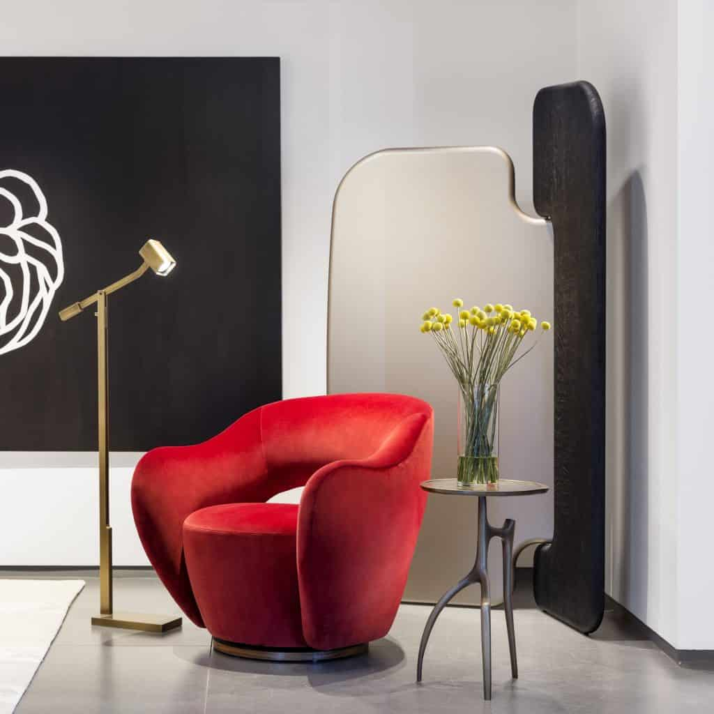 The Holly Hunt Oscar reading lamp and Branche side table with the Vladimir Kagan Wysiwyg chair