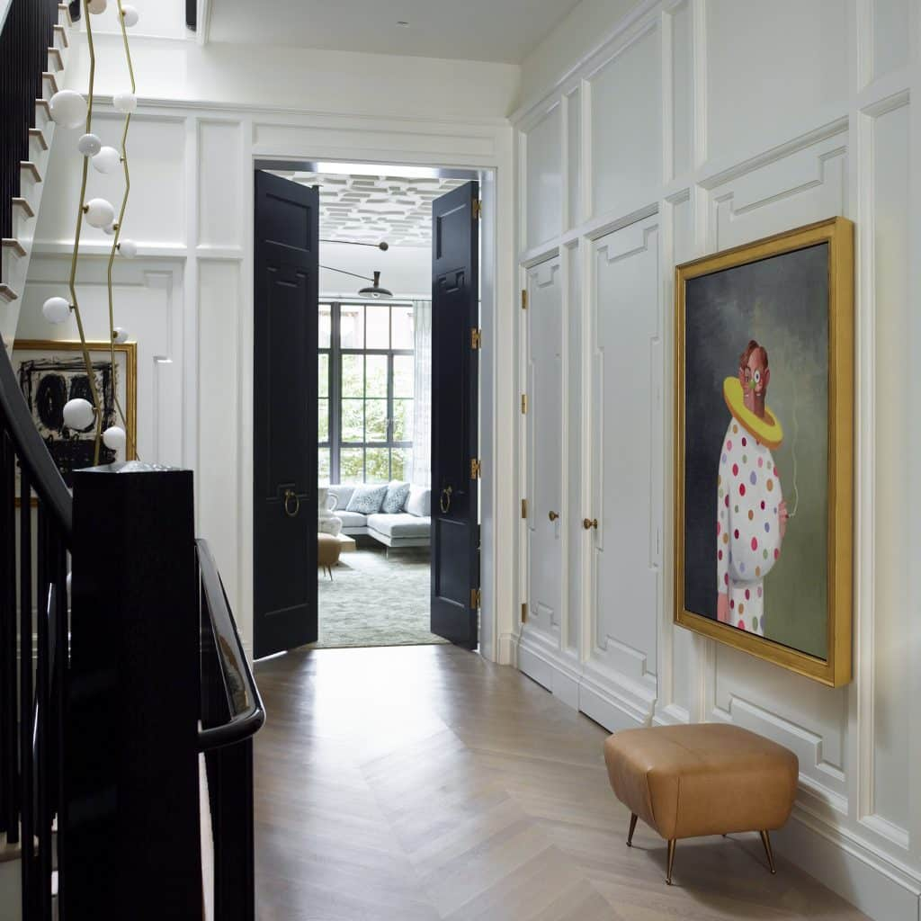 Interior designer Brad Ford West Village townhouse renovation foyer gallery entry George Condo view to living room
