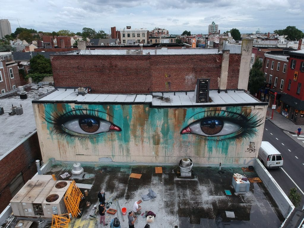 An outdoor mural by street artist My Dog Sighs on the corner of 5th and South Streets in Philadelphia