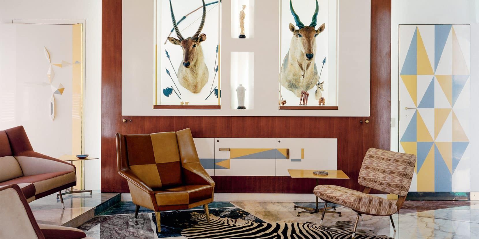 Two antelope heads mounted in the study at Villa Planchart, as seen in the book Gio Ponti, offered by Taschen