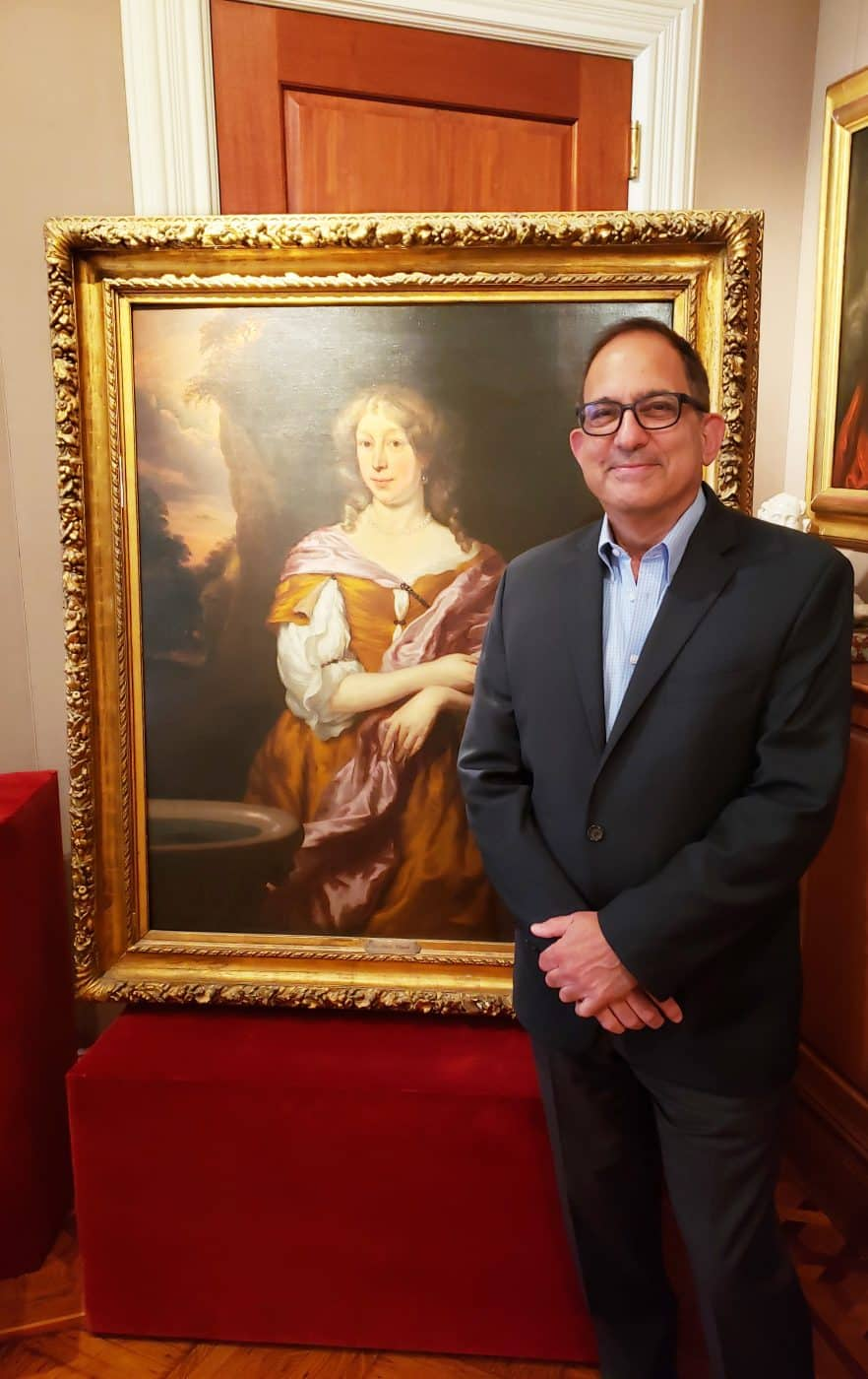 Old Master dealer Robert Simon with Portrait of a Young Lady, 1672, by Dutch painter Nicolaes Maes, in his eponymous Manhattan gallery