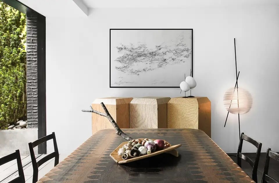 """A drawing from artist Sylvain Rieu-Piquet's """"Tuberose Absolute and Eau"""" series in a roomful of furniture by YMER&MALTA"""