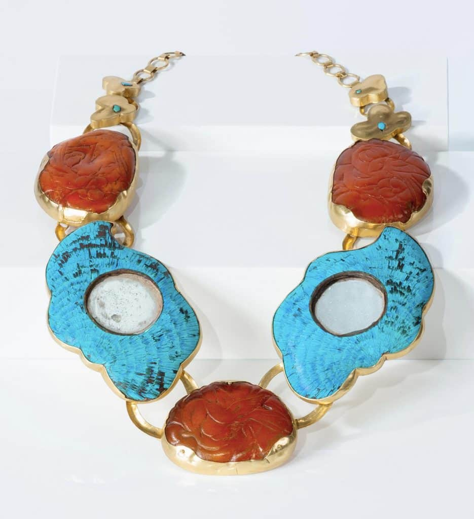 A necklace made for Mimi Lipton by Argentinean artist and architect Daniel Azaro with carved amber and bright-blue kingfisher feathers