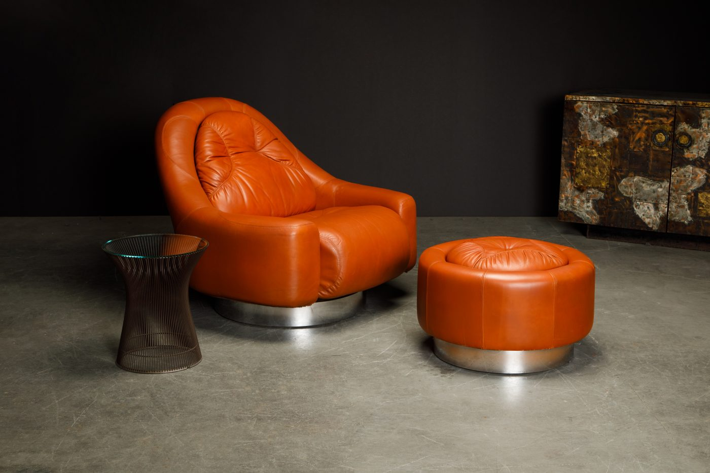 A circa-1971 Zator swivel chair and ottoman by Guido Faleschini for Italian maker i 4 Mariani, offered by Automaton