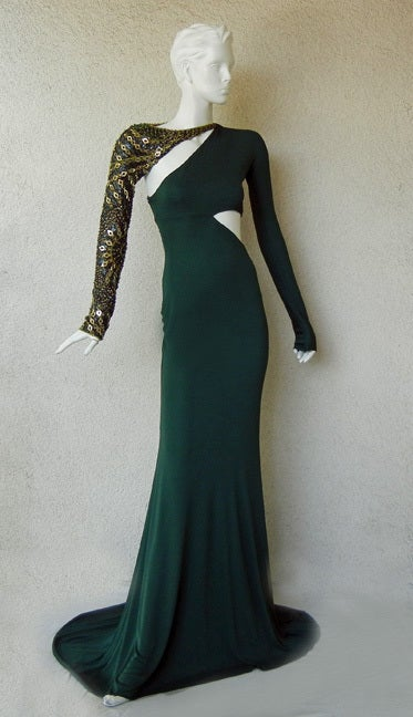 A green bias-cut Emilio Pucci gown, offered by Marilyn Glass