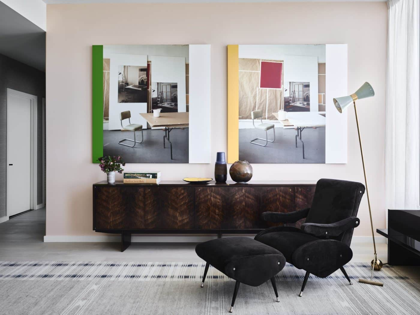 An Osvaldo Borsani armchair and ottoman and aJoaquim Tenreiro jacaranda sideboard in the living room of Gabriel & Guillaume's staged apartment at Fifteen Fifty in San Francisco