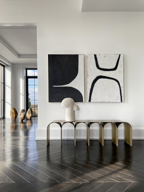 Pietro Franceschini's brass Gold Arch bench in the living room area of Galerie Philia's staged apartment in New York's Walker Tower