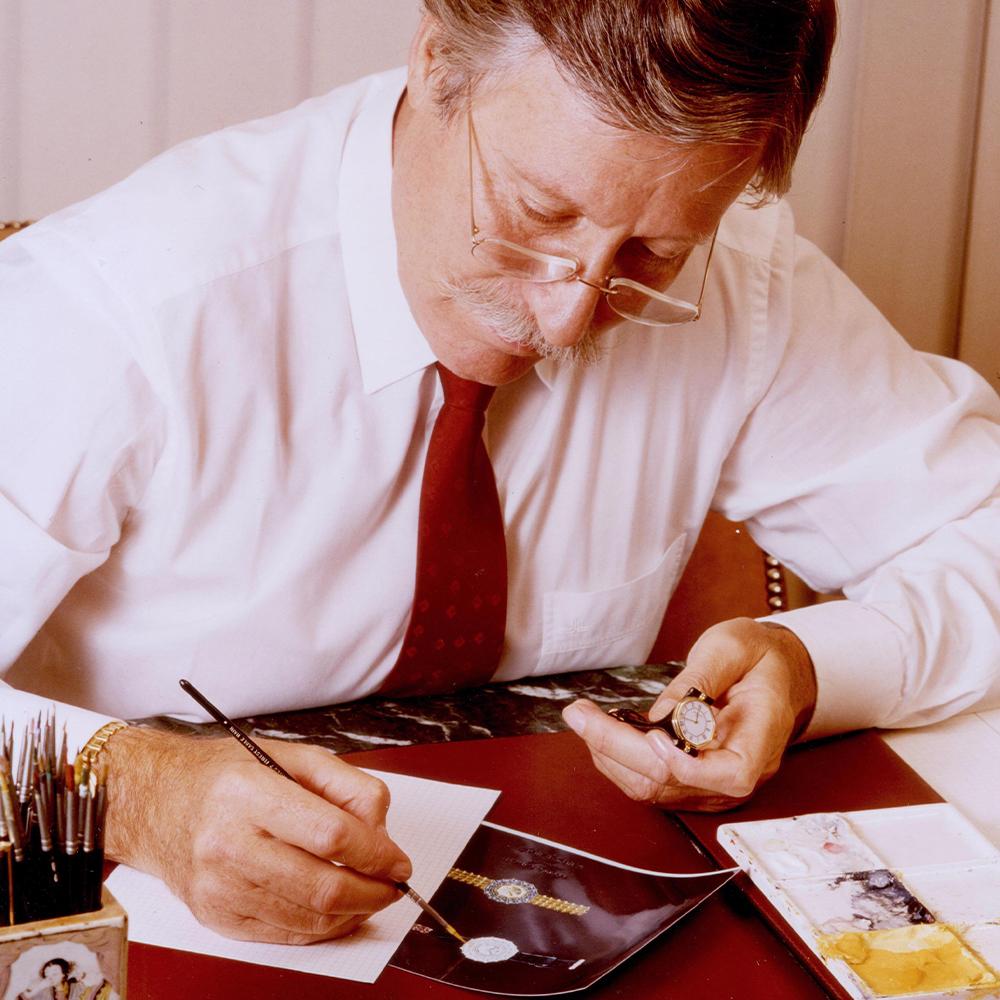 Swiss watchmaker GÉRALD GENTA at his desk creating a watch design