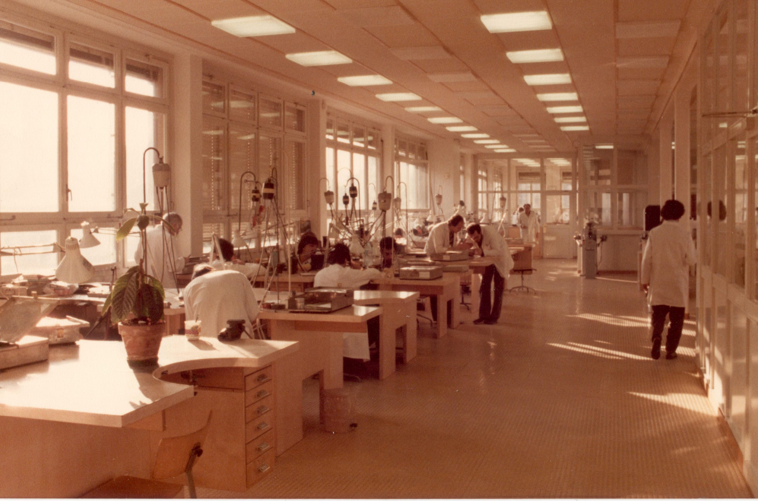 Horologists in white lab coats at Gérald Genta's Geneva atelier in the 1980s