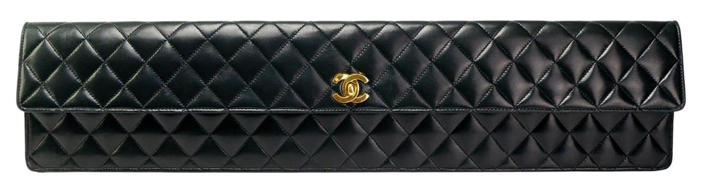 An extra-long black quilted-leather Chanel clutch, offered by House of Carver.