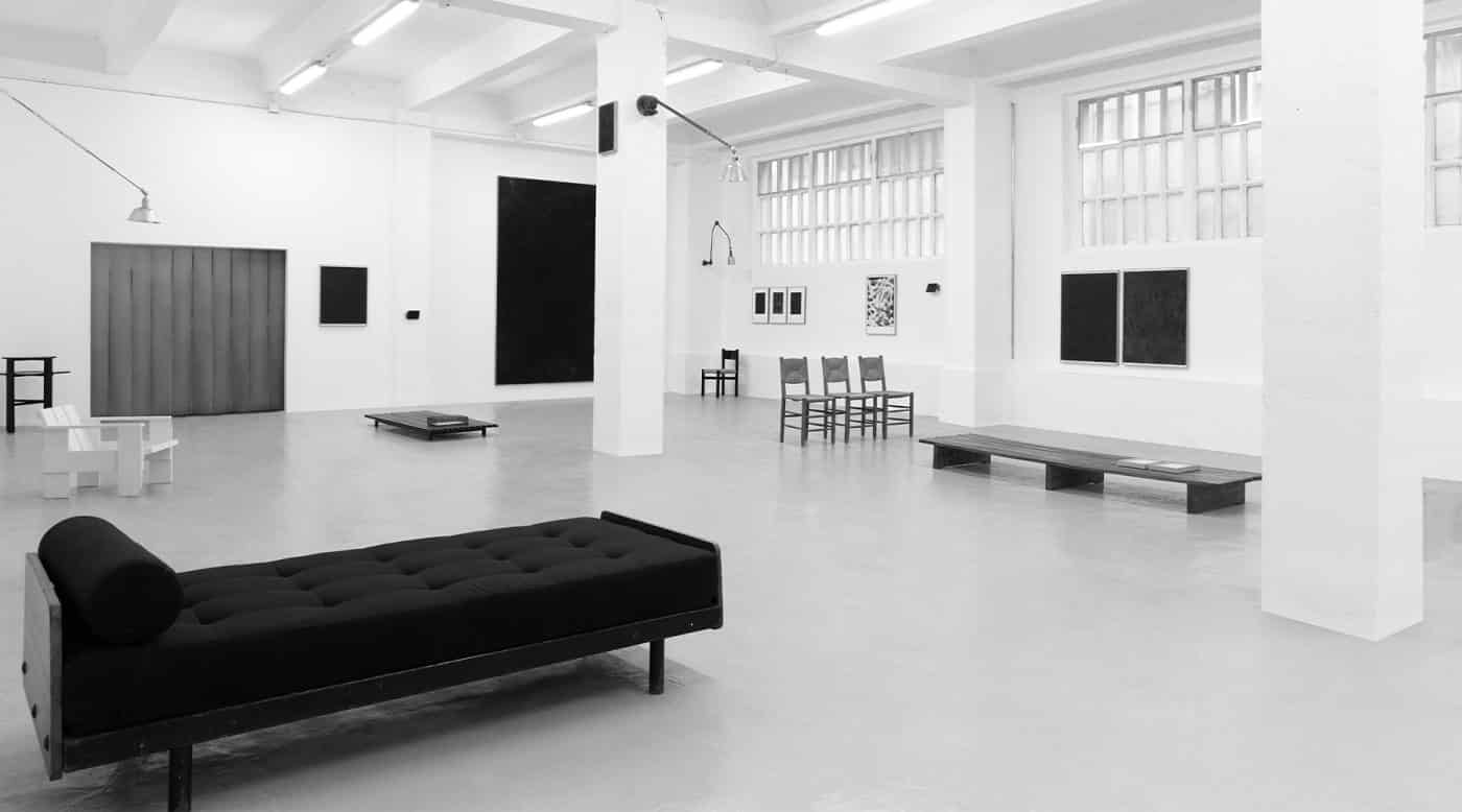 A black-and-white photo of DADA Studios' first exhibition, in October 2016.