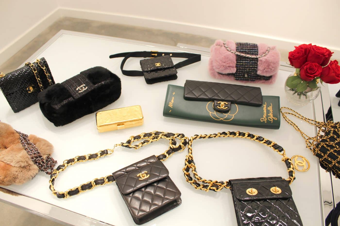 An assortment of small Chanel handbags, belt bags and clutches in a variety of materials and embellishments, offered by House of Carver