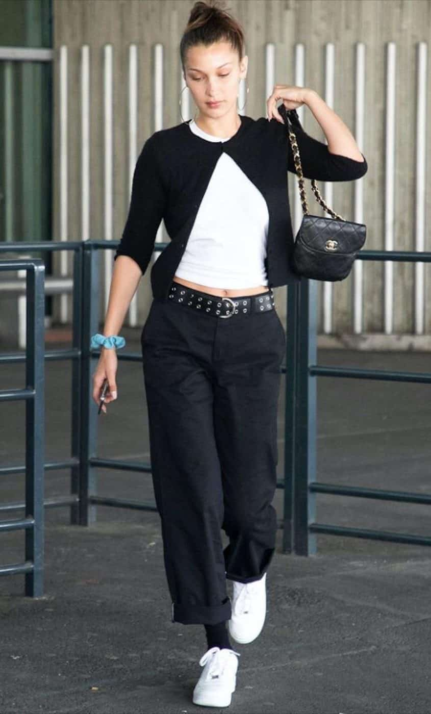 Model Bella Hadid, off duty, carrying a black vintage Chanel bag with a chain strap