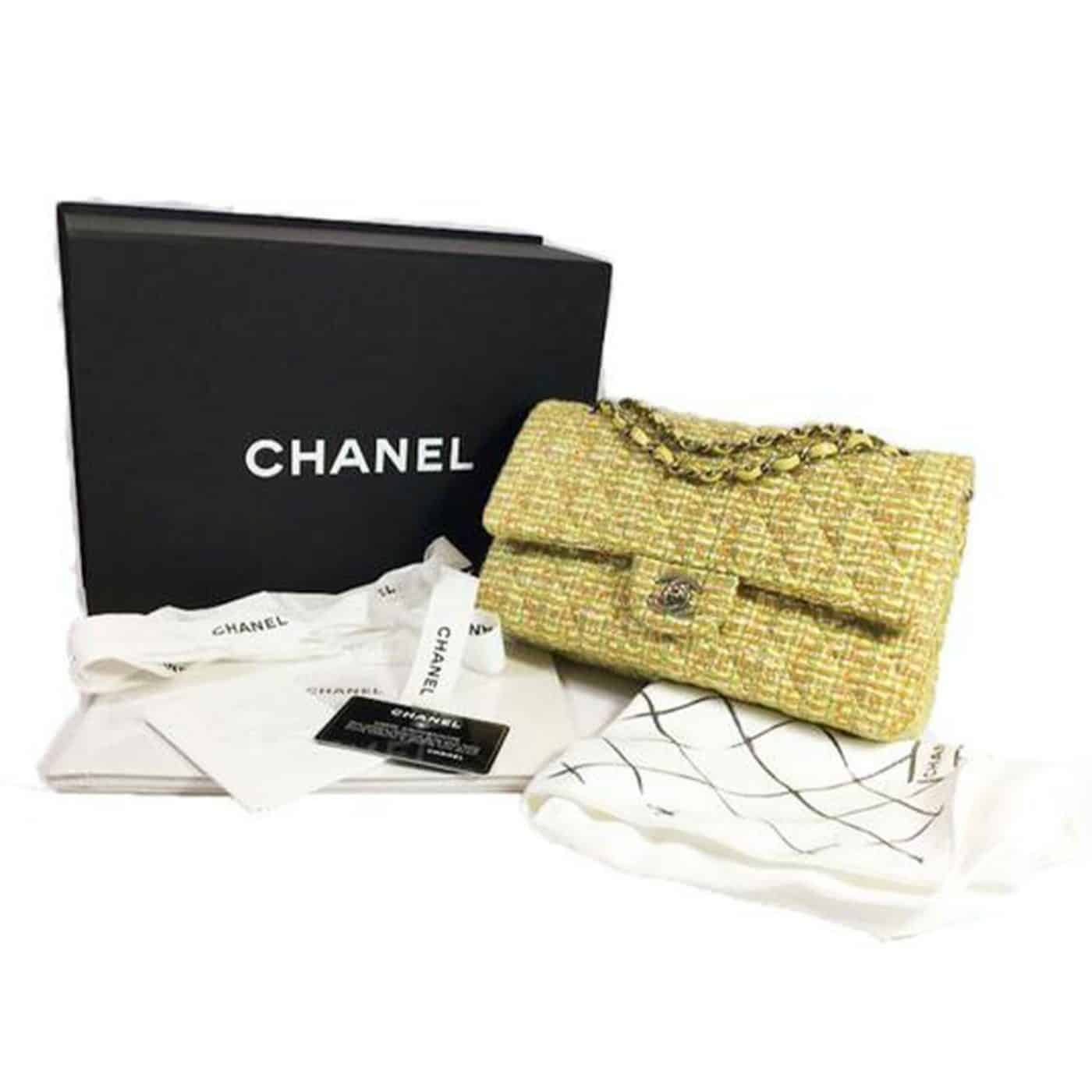 A vintage yellow tweed Chanel bag with its original packaging, offered by House of Carver