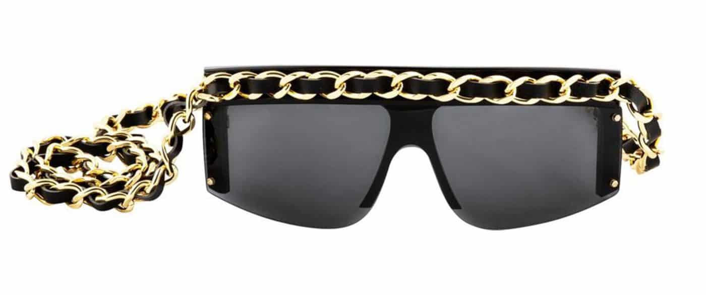 Vintage black Chanel sunglasses with a gold-chain strap, offered by House of Carver