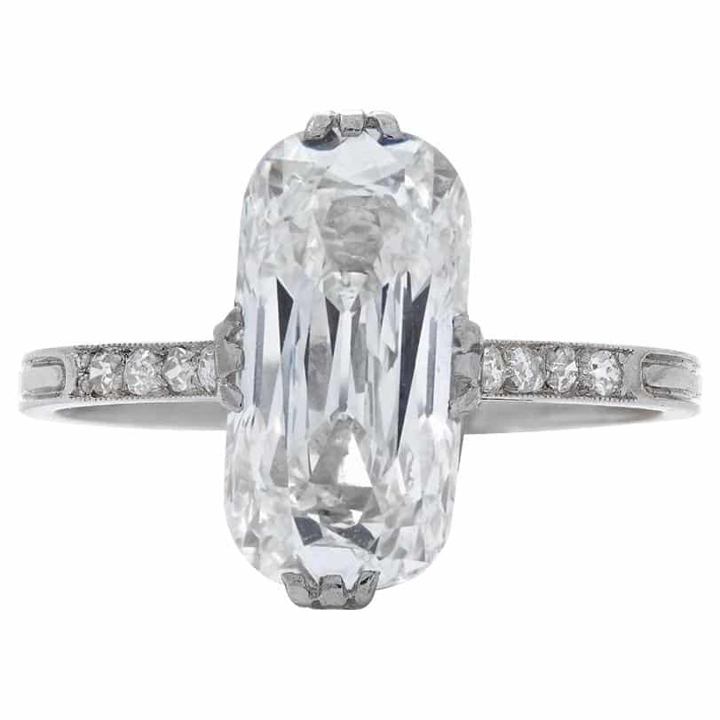 Circa-1910 PLATINUM RING with elongated cushion-cut-diamond center stone, offered by Neil Lane Couture