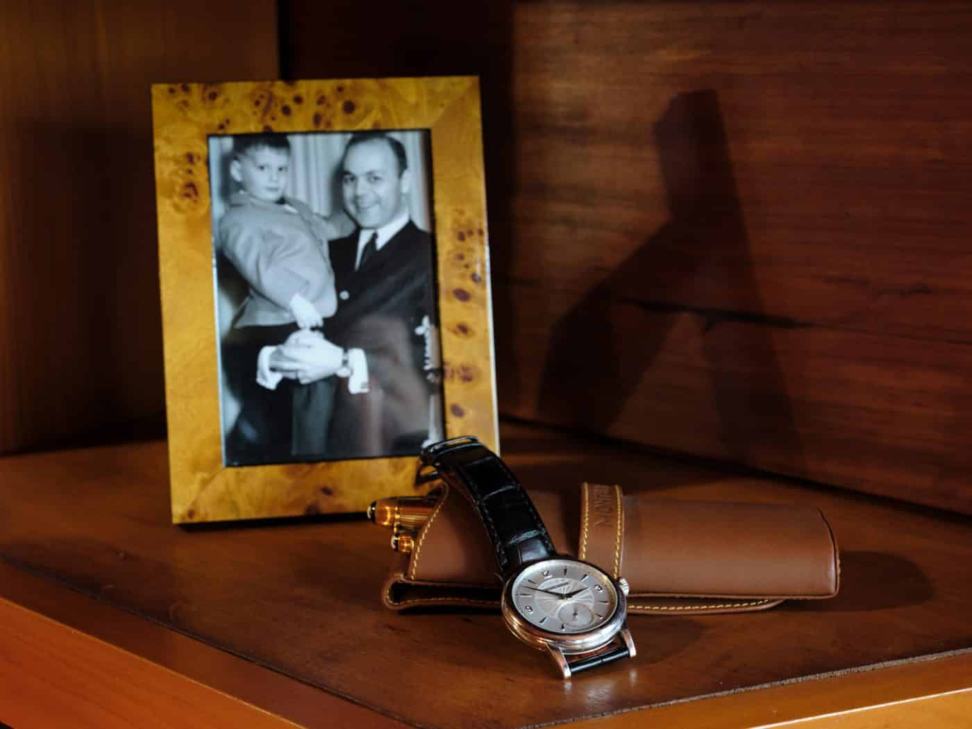 A picture of Todd Levin at three years old with his father sits alongside his father's Montblanc 18 karat yellow gold fountain and ballpoint pens and a Philippe Dufour Simplicity watch with a platinum case with guilloché dial