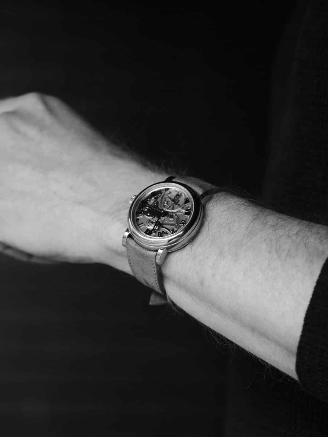 Todd Levin wearing his Roger W. Smith Series 2 Open Dial in an 18 karat white gold case, 40 mm diameter