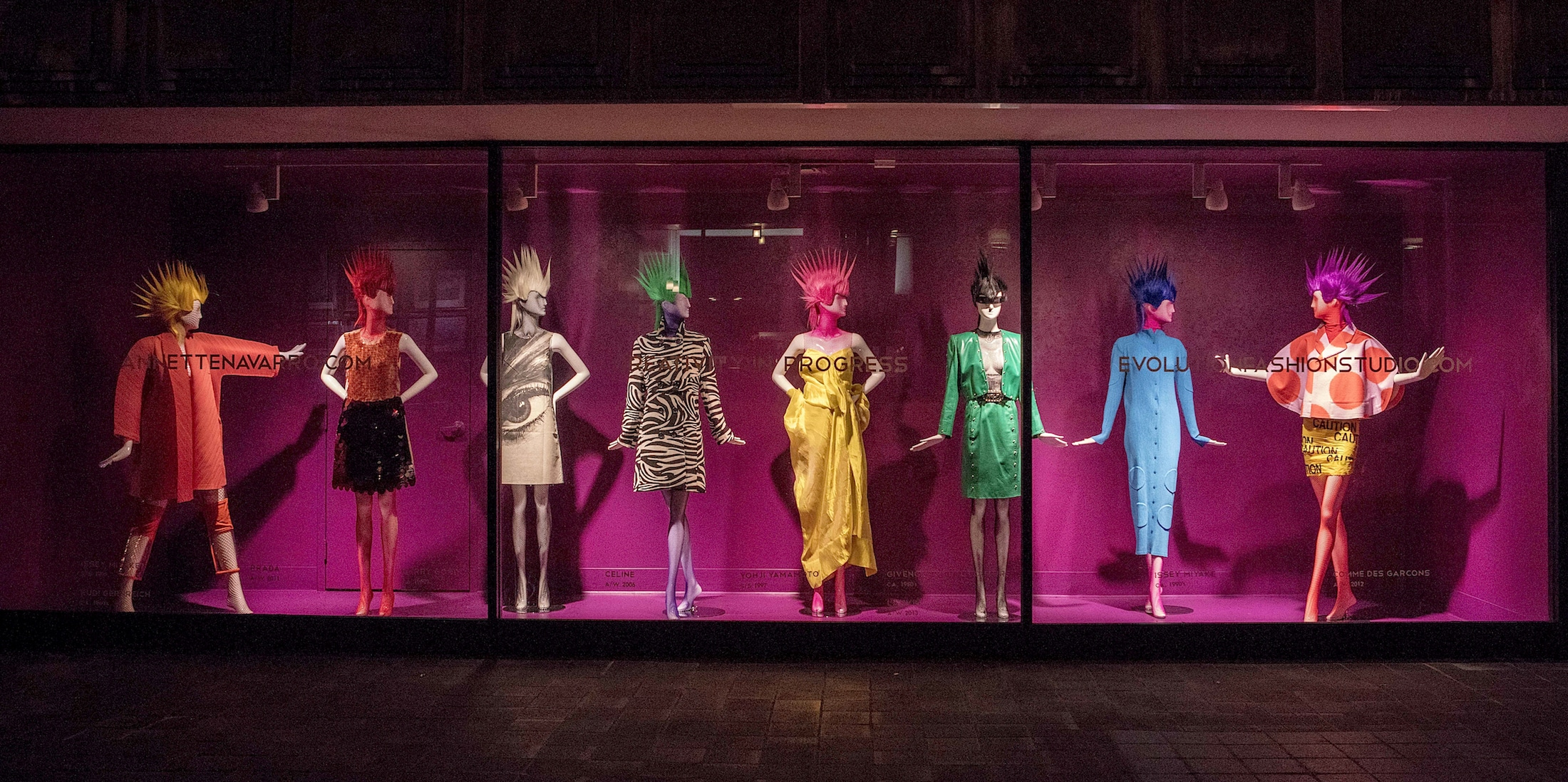 Looks by PRADA, CELINE, GIVENCHY, ISSEY MIYAKE and others in an Evolution window display at the Gidding-Jenny building, in downtown Cincinnati.