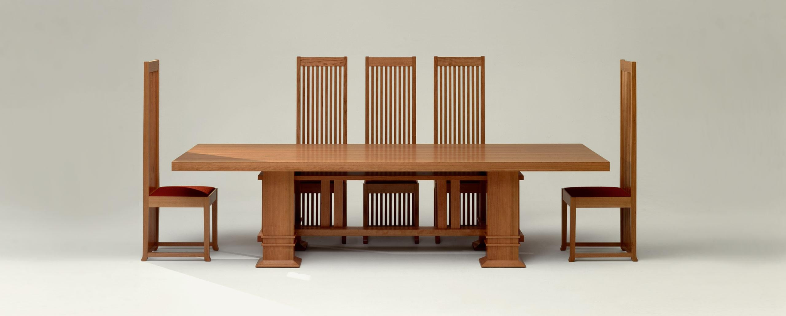 A dining table surrounded by FRANK LLOYD WRIGHT ROBIE CHAIRS, reissued by Cassina and offered by DADA Studios