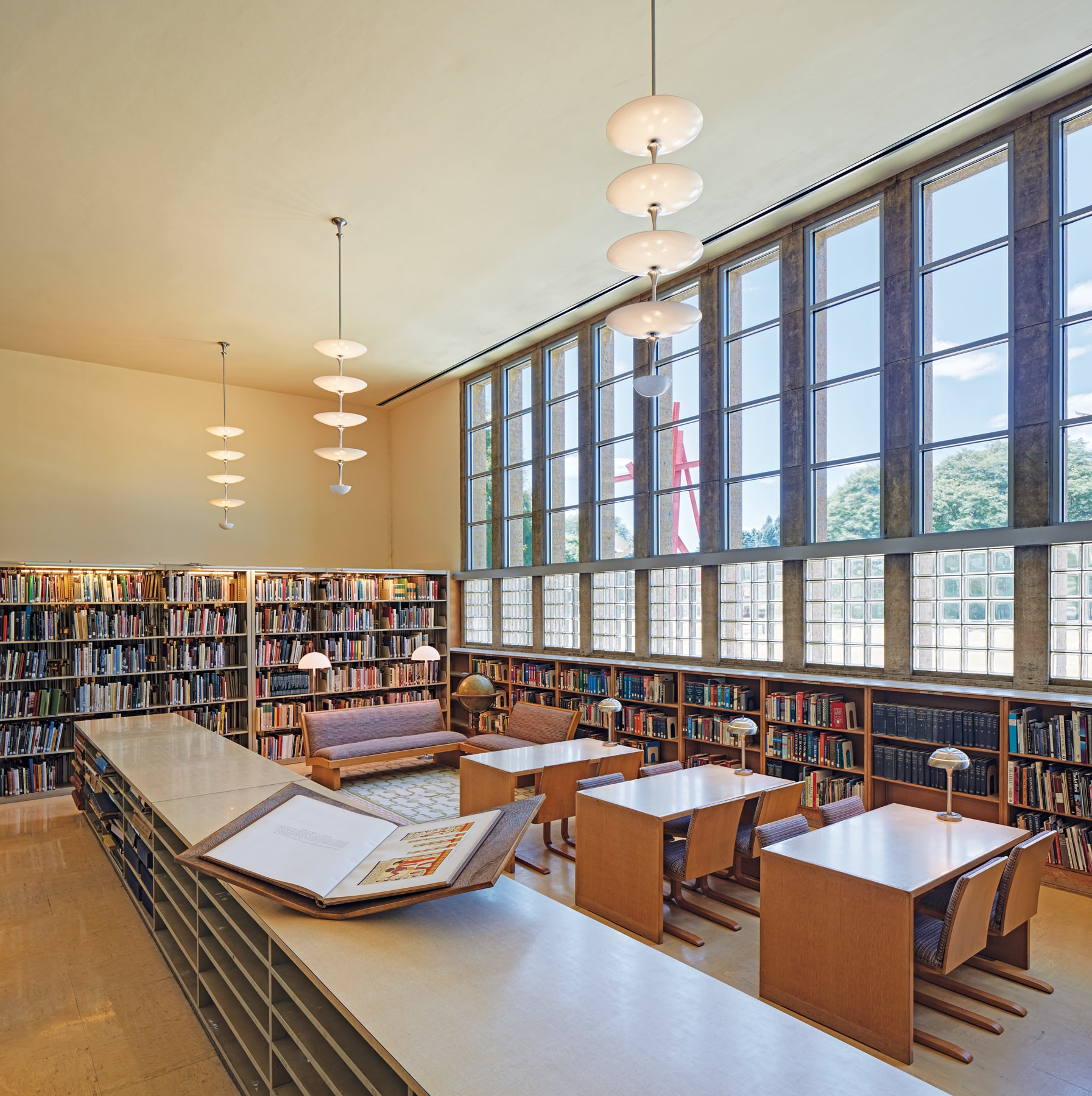 interior of Cranbrook Academy of Art Library, featuring tiered light fixtures and shelves of books