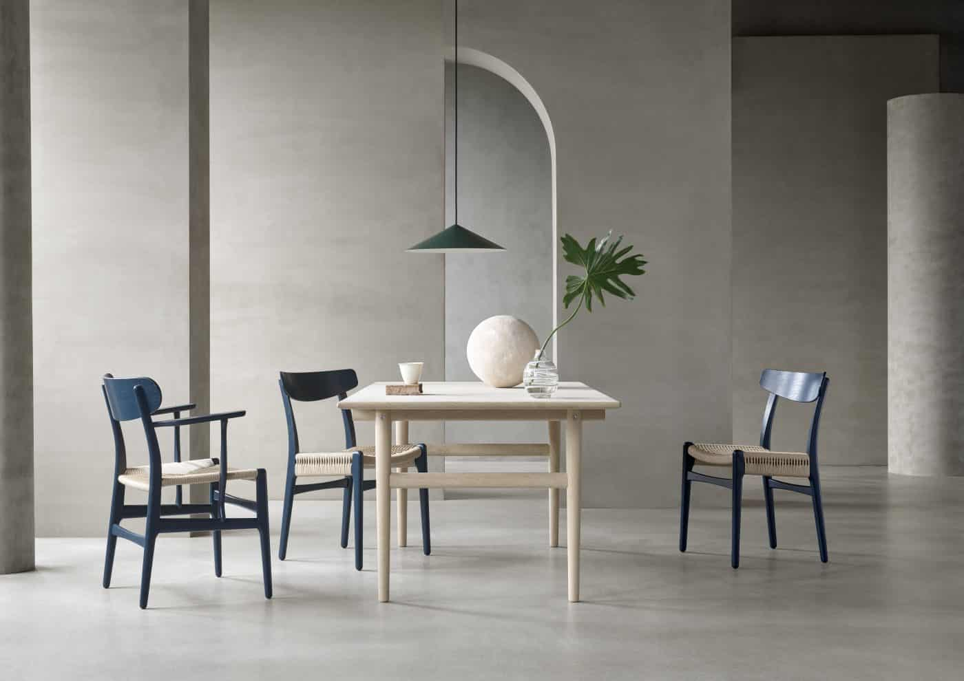 CH26 (far left) and CH23 dining chairs in North Sea blue by Hans J. Wegner and Ilse Crawford