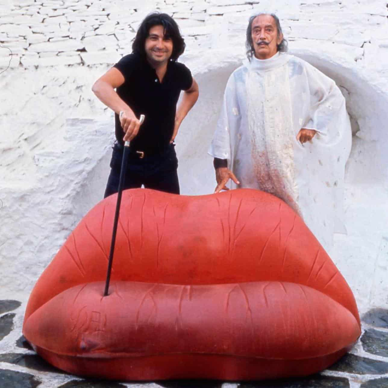 OSCAR TUSQUETS BLANCA and SALVADOR DALÍ pose behind a prototype of the Dalilips sofa.