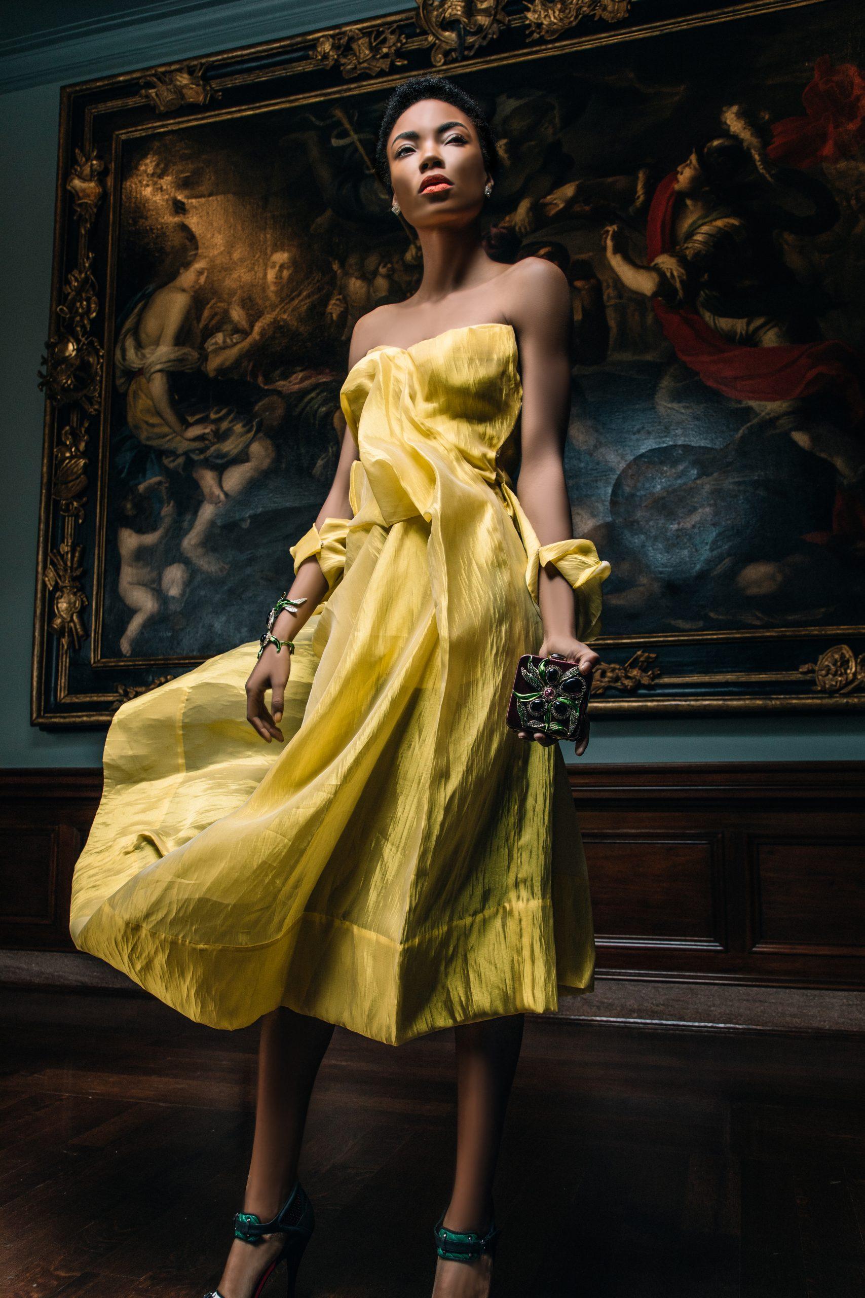 A model in a yellow YOHJI YAMAMOTO dress, sold by Evolution, at the Cincinnati Art Museum