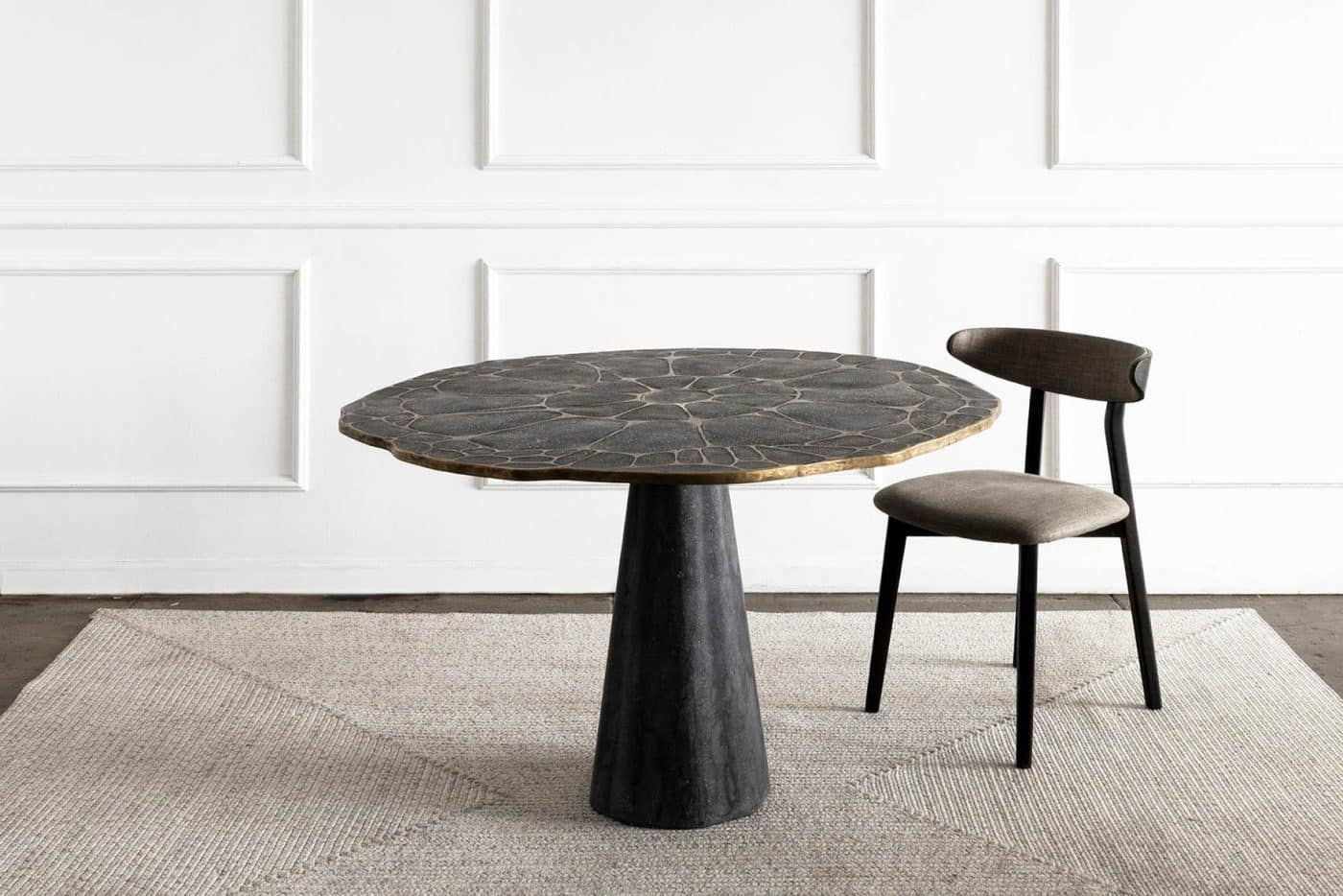 James De Wulf's bronze and concrete Exo dining table.
