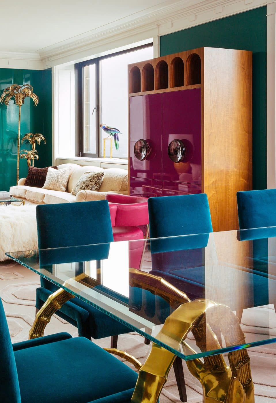 Living and dining room space with magenta Japanese lacquer cabinet