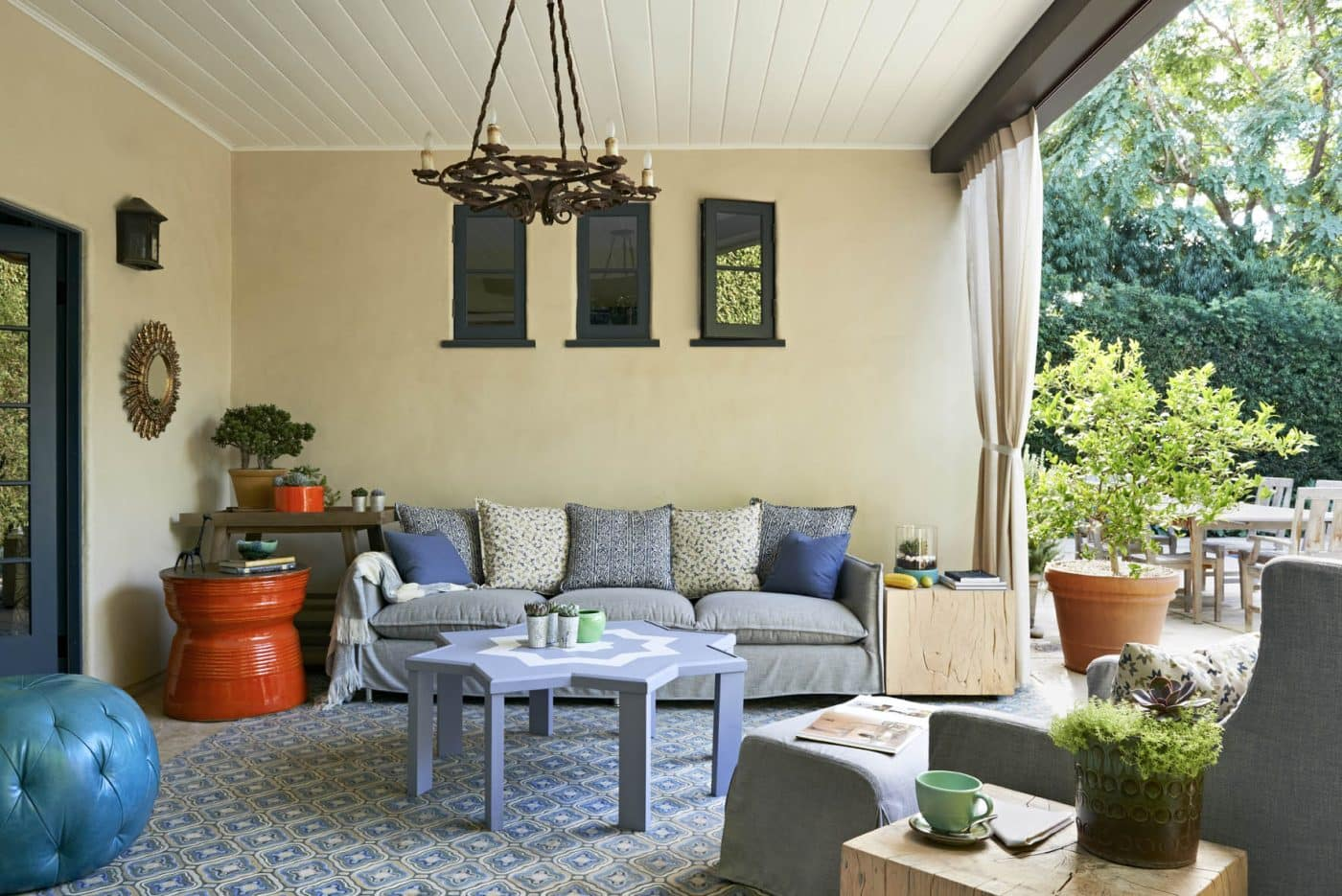 Veranda with couch and coffee table, designed by Coulter