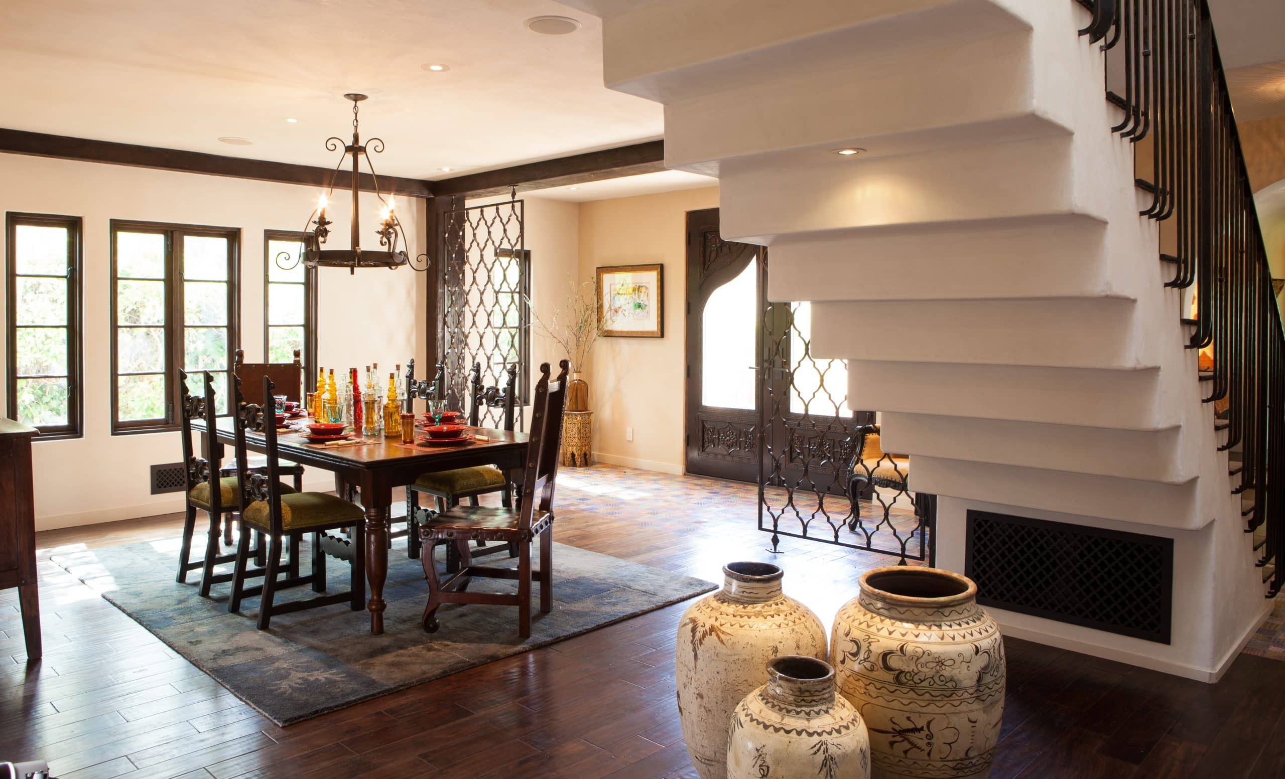 Dining room with exposed staircase, designed by Coulter