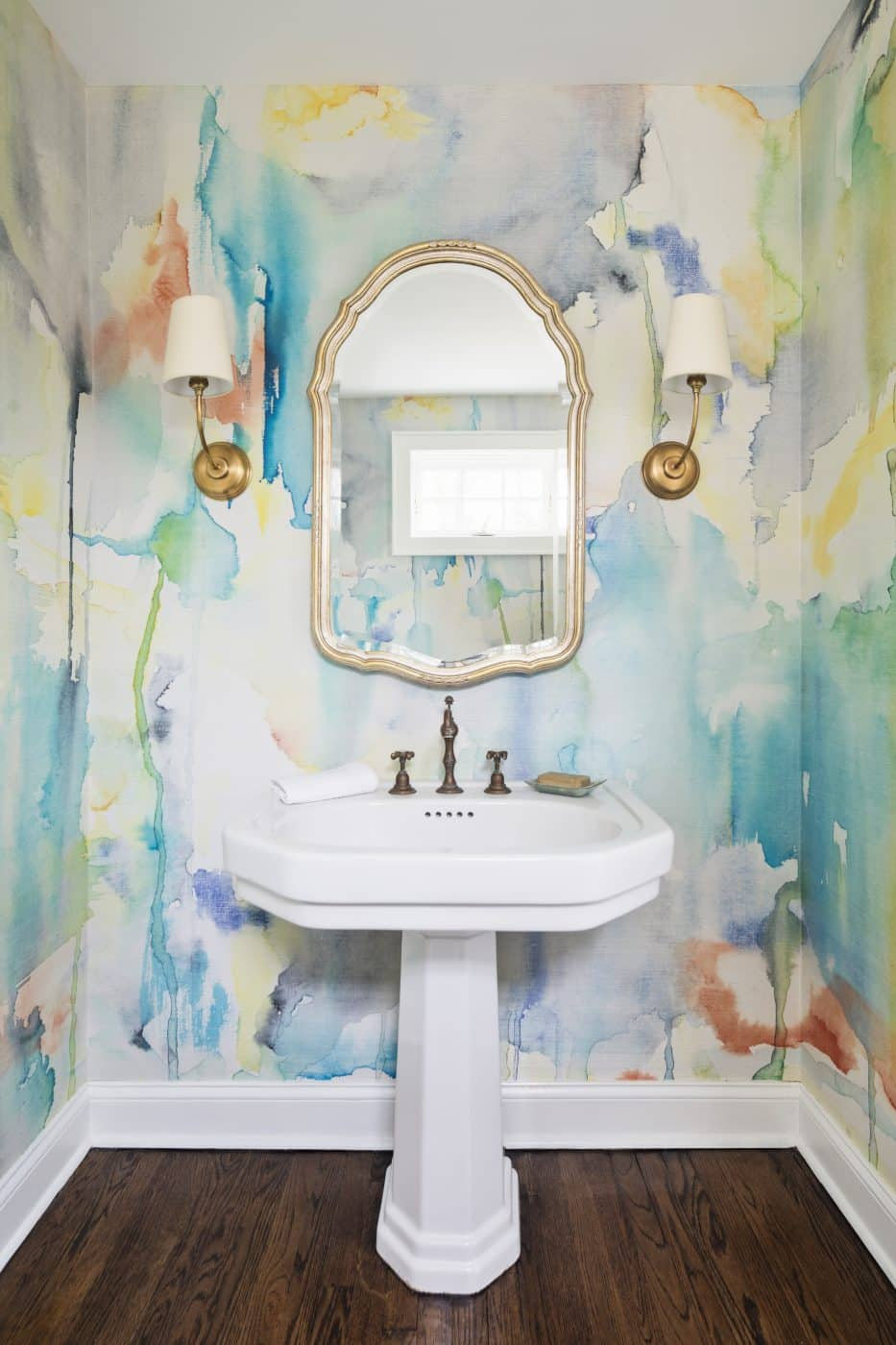The powder room of a Greenwich, Connecticut house with interiors by Danielle Fennoy of Revamp Interior Design