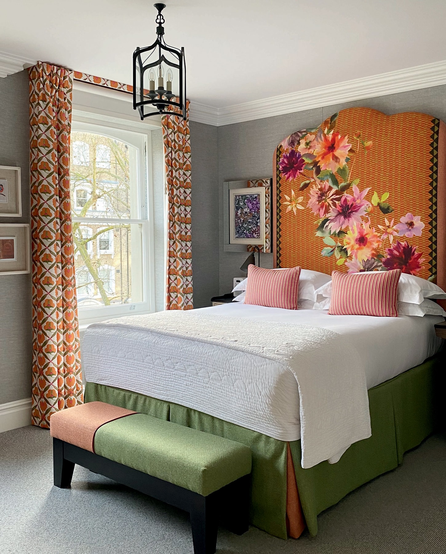 Bedroom with high floral printed headboard