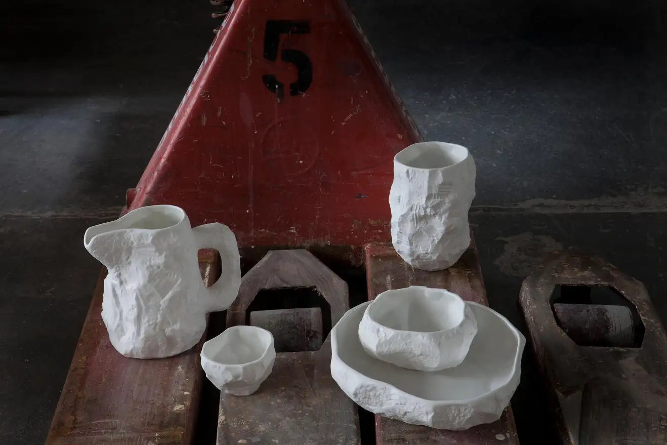 Bone China tableware made by artist Max Lamb from hand-carved plaster molds