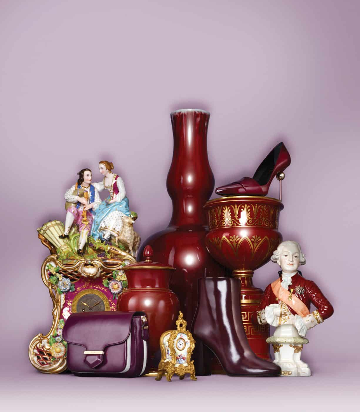A tall ca. 1890 double-gourd vase and other tabletop decor provide a lavish backdrop for plum-colored accessories in an image from T Magazine