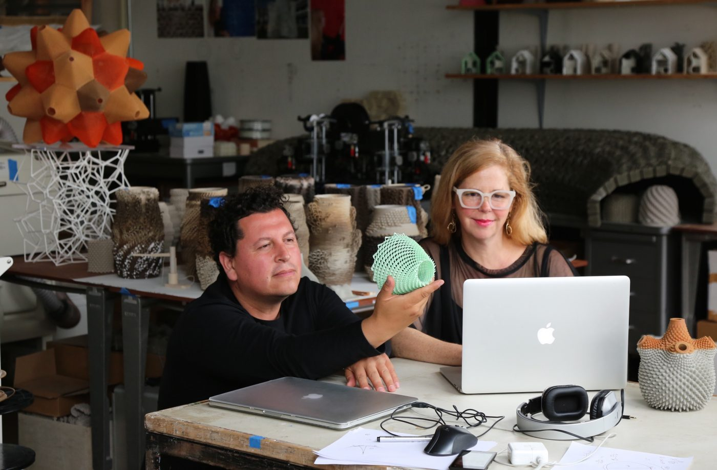 Photo of ceramists Ronald Rael and Virginia San Fratello incorporating 3D-printing techniques into their practice